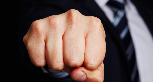 Businessman showing clenched fist to camera.